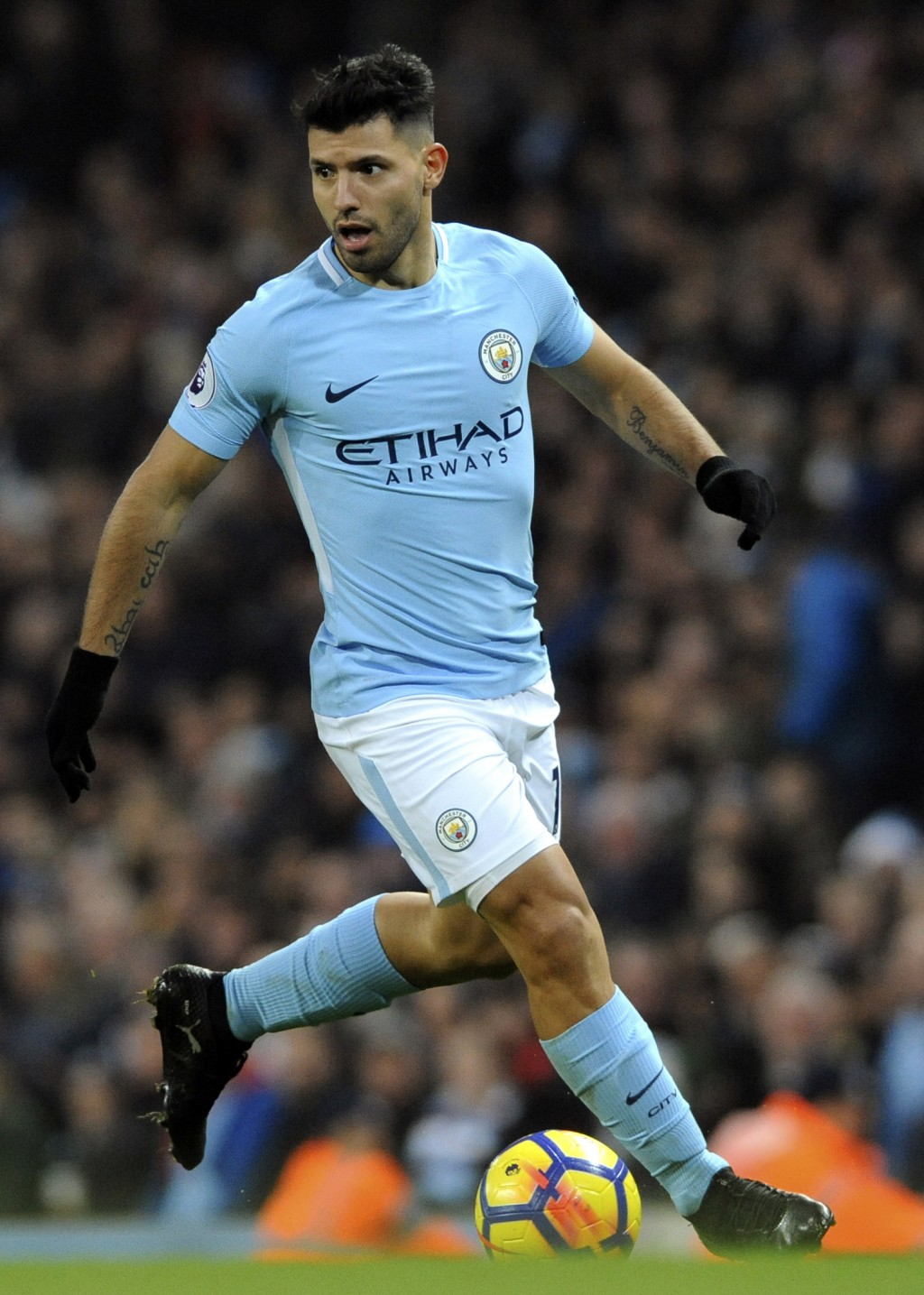 Manchester City's Sergio Aguero controls the ball during the English Premier League soccer match between Manchester City and Bournemouth at Etihad sta...