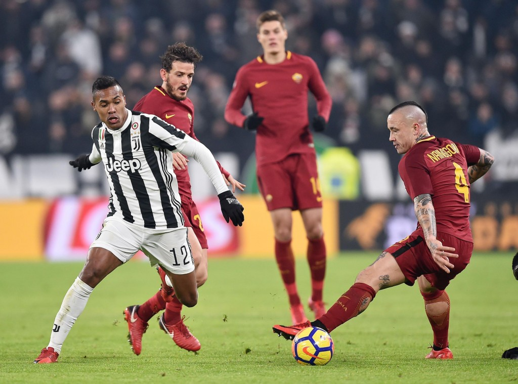 Juventus' Alex Sandro, left, and Roma's Radja Nainggolan vie for the ball during the Italian Serie A soccer match in Turin, Italy, Saturday, Dec. 23, ...