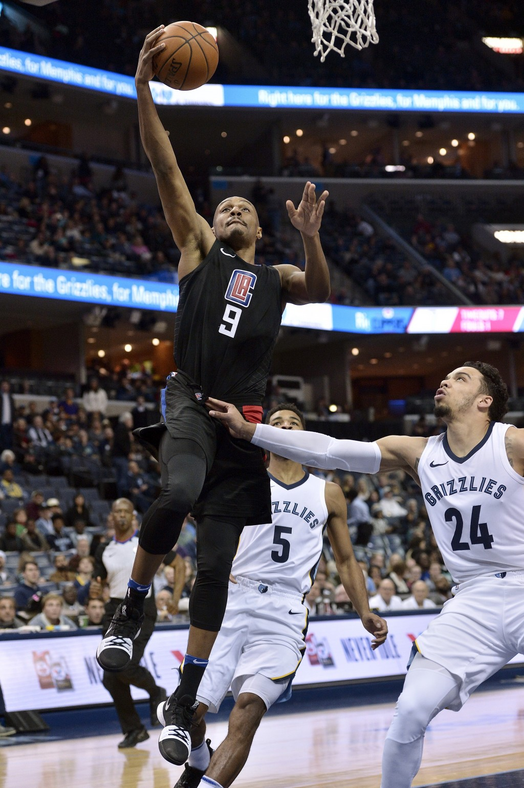 Los Angeles Clippers guard C.J. Williams (9)shoots against Memphis Grizzlies forward Dillon Brooks (24) in the first half of an NBA basketball game Sa...