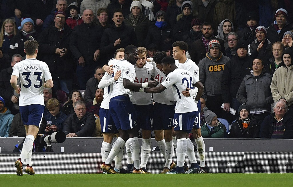 Tottenham Hotspur's Harry Kane, centre, celebrates scoring his side's first goal of the game with team mates during the English Premier League soccer ...