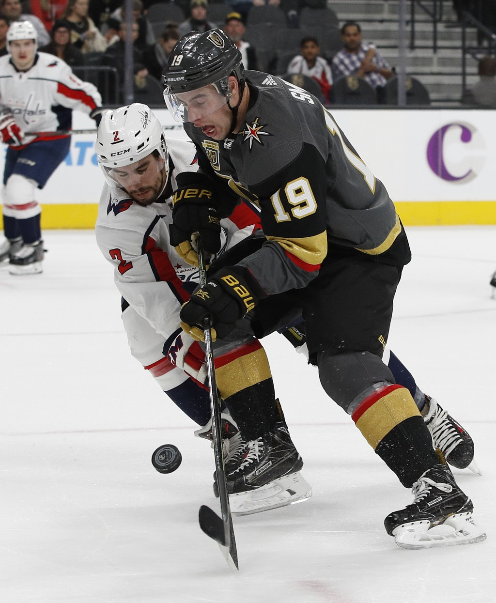 Vegas Golden Knights right wing Reilly Smith (19) and Washington Capitals defenseman Matt Niskanen (2) vie for the puck during the first period of an ...