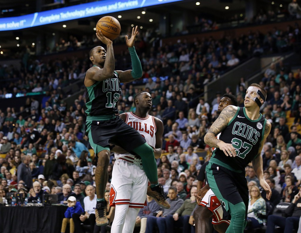 Boston Celtics' Terry Rozier shoots next to Chicago Bulls' Jerian Grant during the second quarter of an NBA basketball game in Boston on Saturday, Dec...