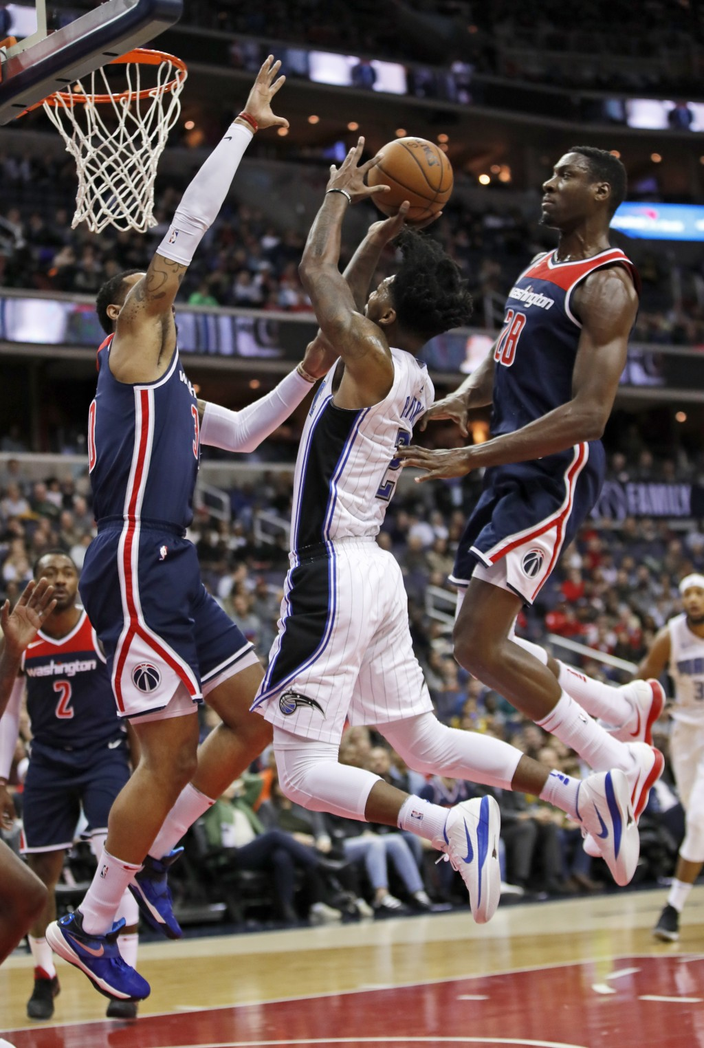 Washington Wizards forward Mike Scott, left, and center Ian Mahinmi, right, from France, combine to defend Orlando Magic guard Elfrid Payton during th...