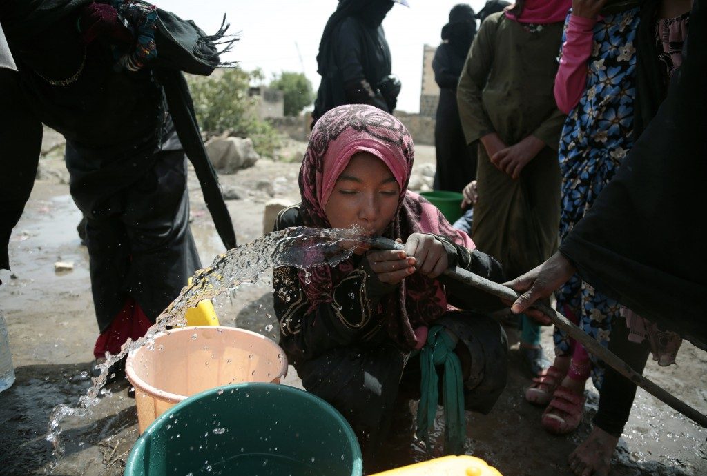 A girl drinks water from a well that alleged to be contaminated water with the bacterium Vibrio cholera, on the outskirts of Sanaa, Yemen on July 12, ...