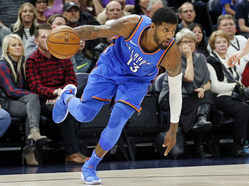 Oklahoma City Thunder forward Paul George (13) drives against the Utah Jazz in the first half during an NBA basketball game Saturday, Dec. 23, 2017, i...