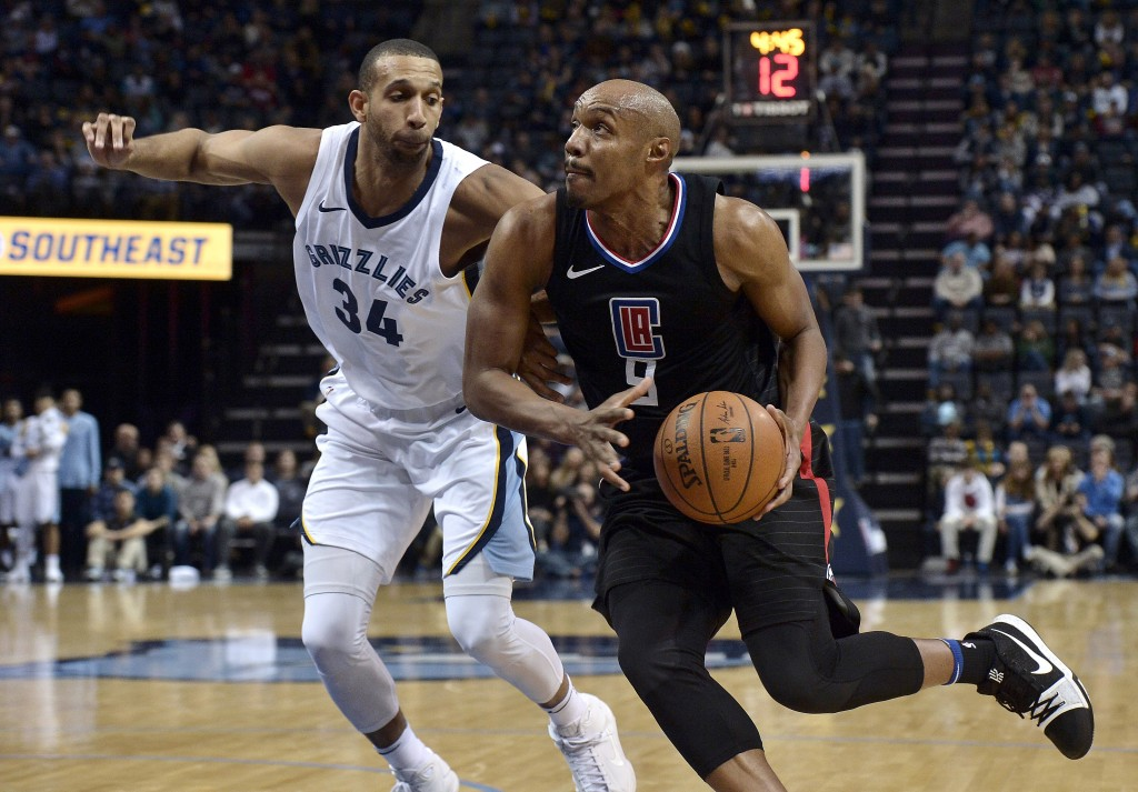 Los Angeles Clippers guard C.J. Williams (9) drives against Memphis Grizzlies forward Brandan Wright (34) in the first half of an NBA basketball game ...