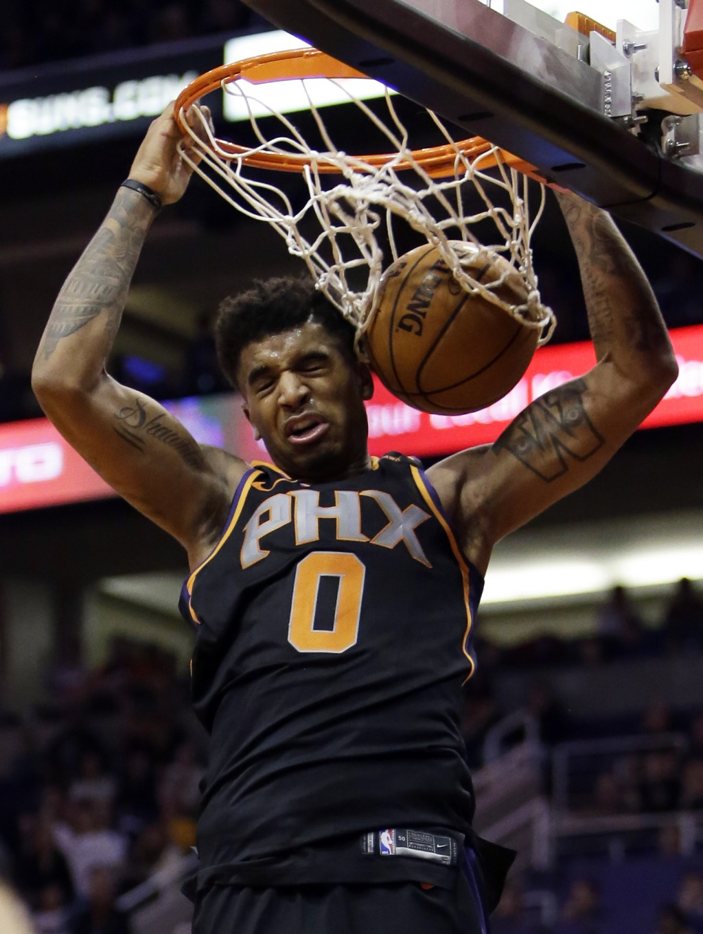 Phoenix Suns forward Marquese Chriss dunks against the Minnesota Timberwolves in the fourth quarter during an NBA basketball game, Saturday, Dec. 23, ...