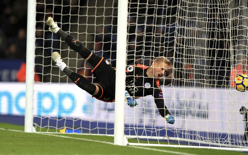 Leicester City goalkeeper Kasper Schmeichel dives in vain as Juan Mata, not pictured, scores his side's second goal of the game during their English P...