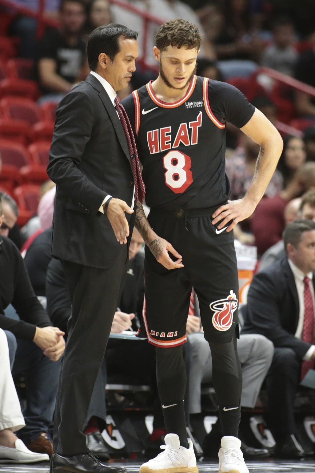 Miami Heat head Coach Erik Spoelstra talks to Miami Heat guard Tyler Johnson (8) during the first half of an NBA basketball game against the New Orlea...