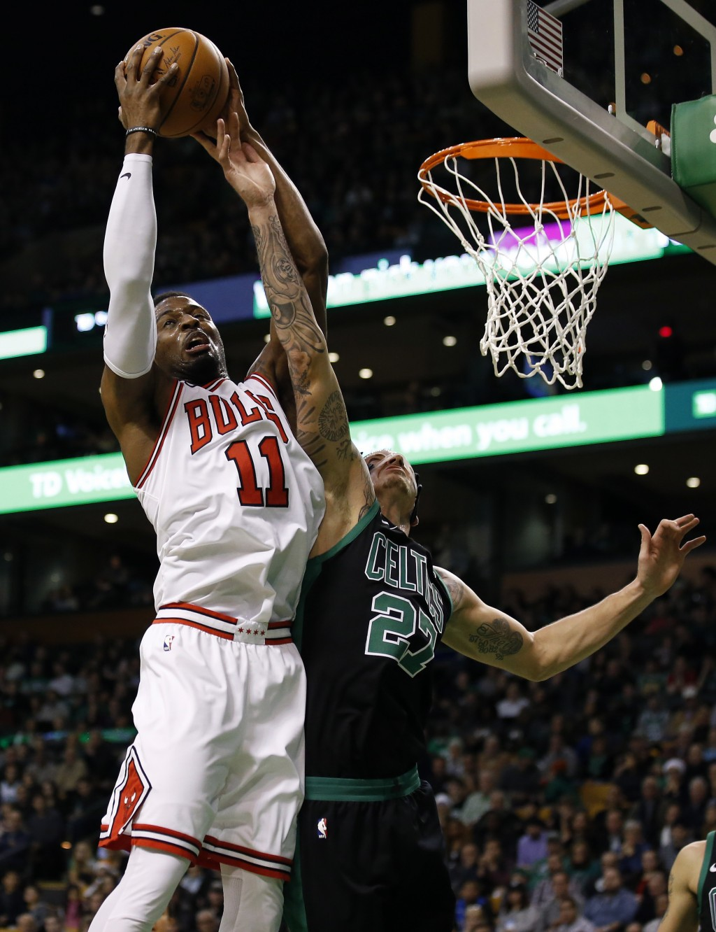 Chicago Bulls' David Nwaba (11) grabs a rebound over Boston Celtics' Daniel Theis during the fourth quarter of Boston's 117-92 win in an NBA basketbal...