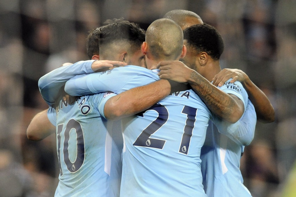 Manchester City's Sergio Aguero, left, celebrates with teammates after scoring his second goal, his side's third, during the English Premier League so...