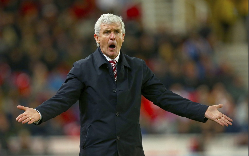 Stoke City manager Mark Hughes gestures on the touchline during the English Premier League soccer match against West Bromwich at the Bet365 Stadium, i...