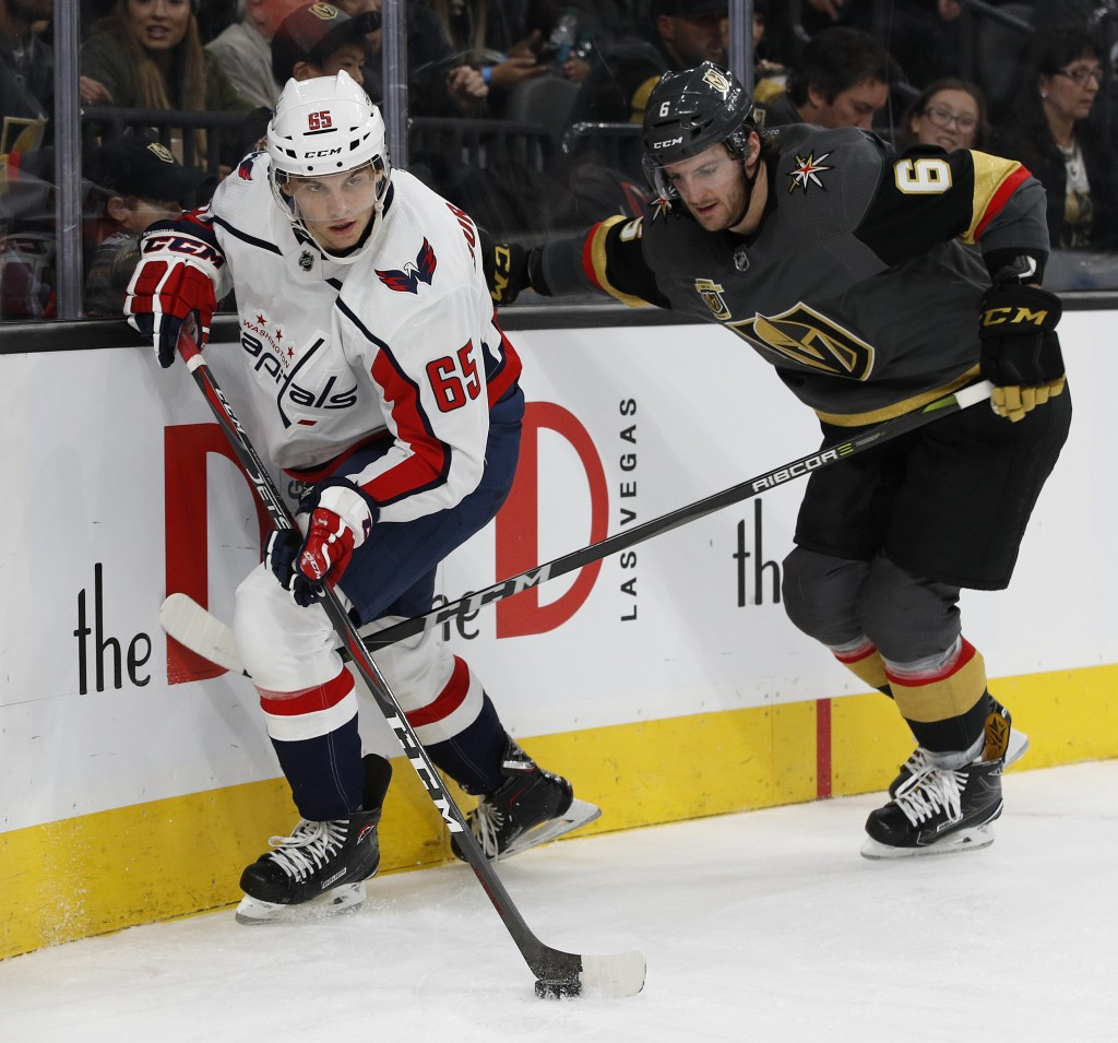 Washington Capitals left wing Andre Burakovsky, left, skates around Vegas Golden Knights defenseman Colin Miller during the second period of an NHL ho...
