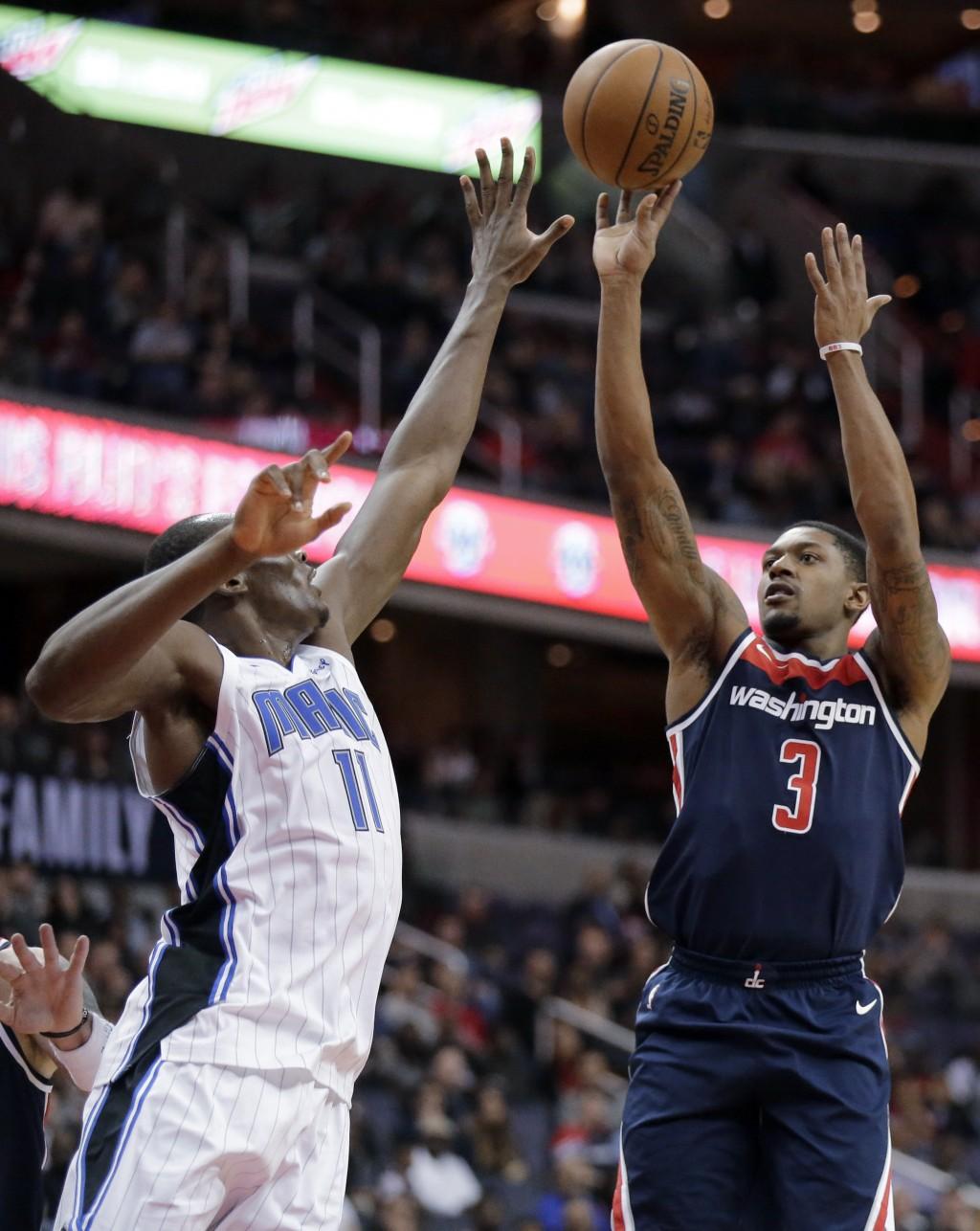 Washington Wizards guard Bradley Beal (3) shoots over Orlando Magic center Bismack Biyombo (11) during the second half of an NBA basketball game Satur...