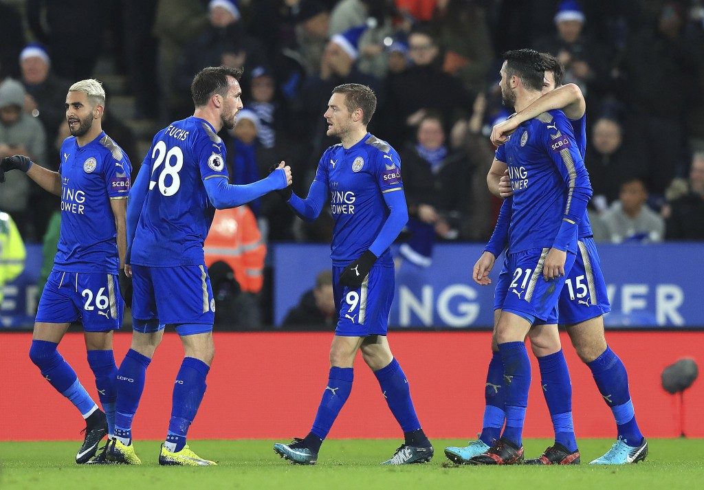 Leicester City's Jamie Vardy, center, celebrates with teammates after scoring his side's first goal of the game during their English Premier League so...