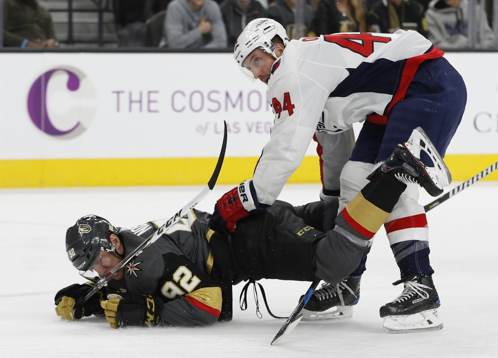 Vegas Golden Knights left wing Tomas Nosek (92) falls over Washington Capitals defenseman Brooks Orpik (44) during the first period of an NHL hockey g...