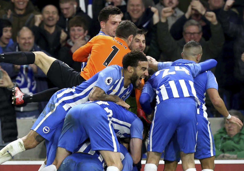 Brighton's Pascal Gross celebrates with teammates after scoring his side's first goal, during the English Premier League soccer match between Brighton...