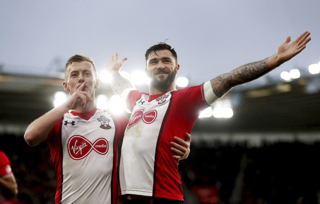 Southampton's Charlie Austin, right, celebrates scoring his side's first goal of the game during the English Premier League soccer match between South...