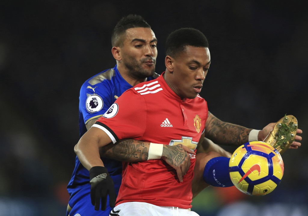 Leicester City's Danny Simpson, left, and Manchester United's Anthony Martial battle for the ball during their English Premier League soccer match at ...