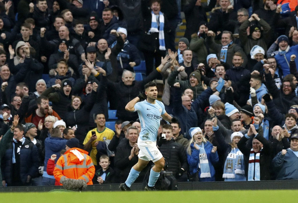 Manchester City's Sergio Aguero celebrates scoring his side's first goal of the game, during the English Premier League soccer match between Mancheste...