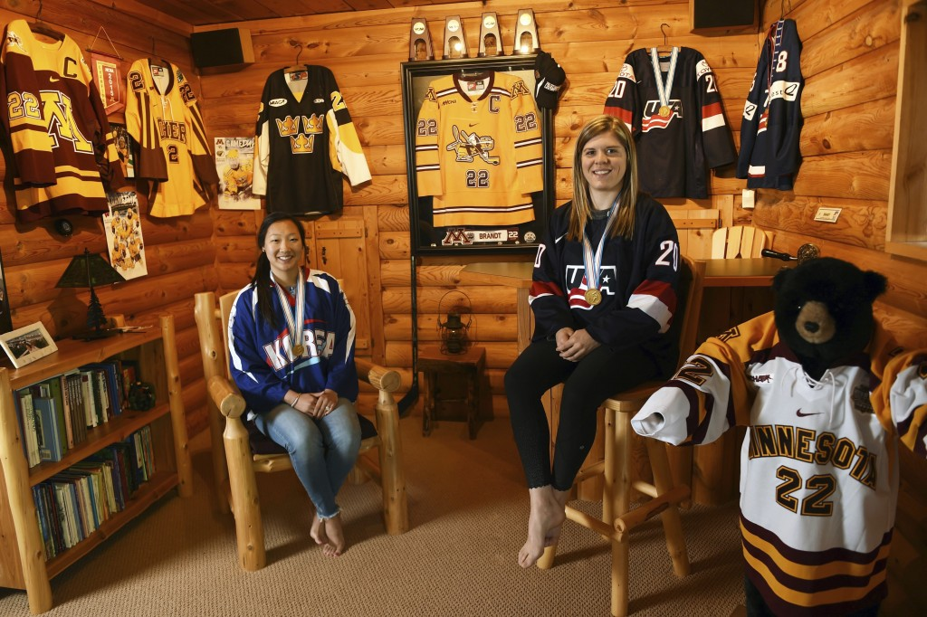 In this May 11, 2017 photo, sisters Marissa, left, and Hannah Brandt, pose in their family home in Vadnais Heights. Minn. The pair will be playing in ...