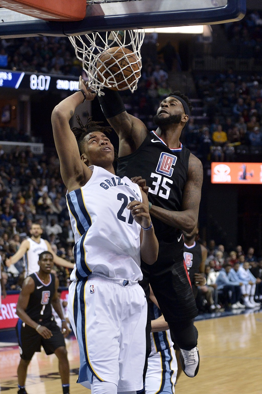 Los Angeles Clippers center Willie Reed (35) scores against Memphis Grizzlies center Deyonta Davis (21) in the first half of an NBA basketball game Sa...