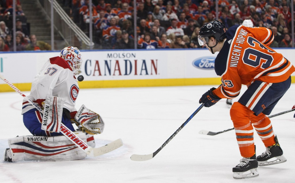 Montreal Canadiens goalie Antti Niemi (37) makes a save against Edmonton Oilers' Ryan Nugent-Hopkins (93) during second-period NHL hockey game action ...