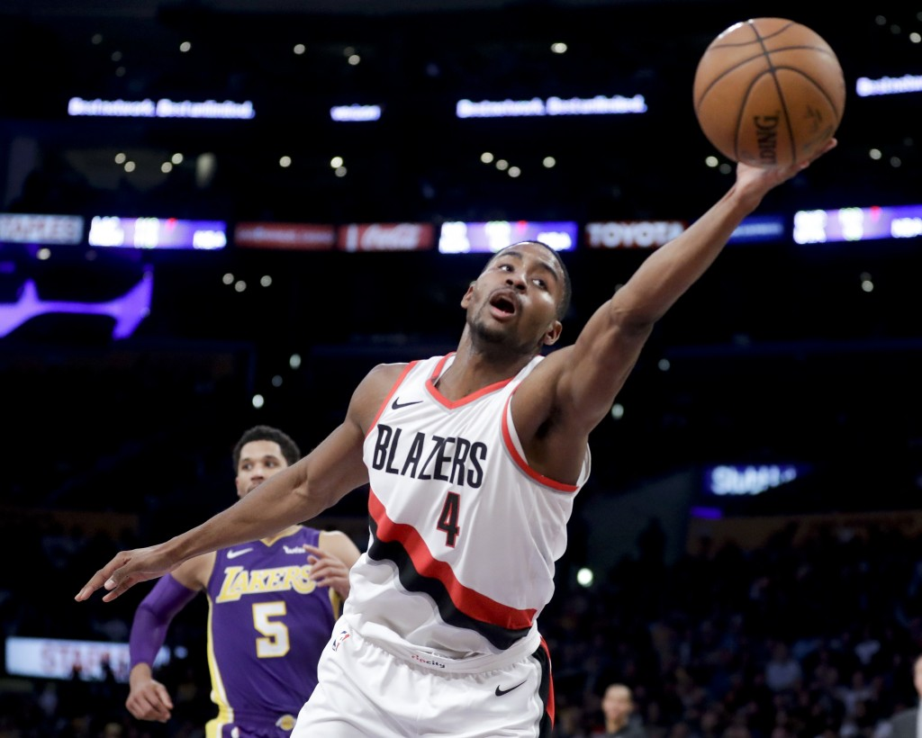 Portland Trail Blazers forward Maurice Harkless reaches for a loose ball during the second half of the team's NBA basketball game against the Los Ange...