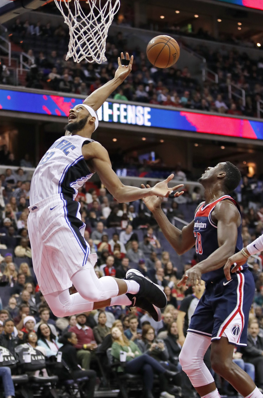 Orlando Magic forward Adreian Payne (33) loses the ball as Washington Wizards center Ian Mahinmi (28), from France, defends during the first half of a...