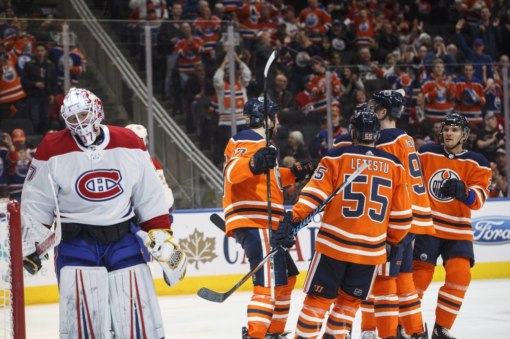 Montreal Canadiens goalie Antti Niemi (37) reacts as the Edmonton Oilers celebrate a goal during second-period NHL hockey game action in Edmonton, Alb...