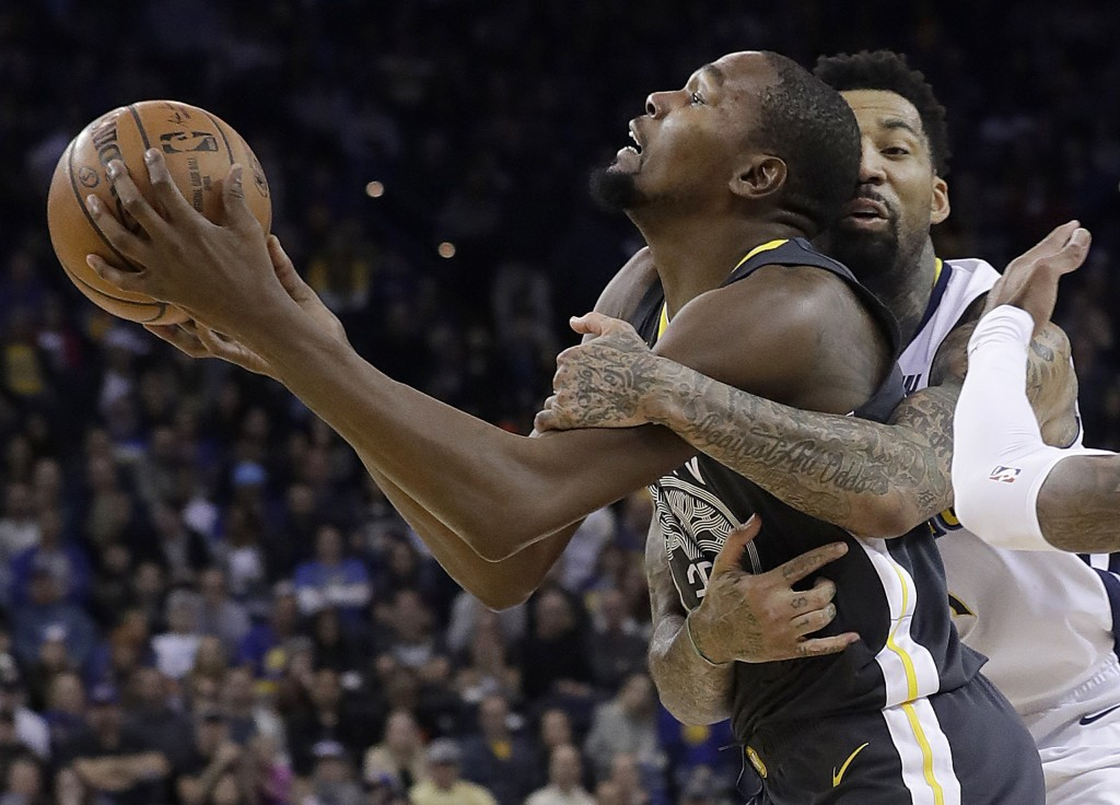 Golden State Warriors forward Kevin Durant, left, is fouled by Denver Nuggets forward Wilson Chandler during the second half of an NBA basketball game...