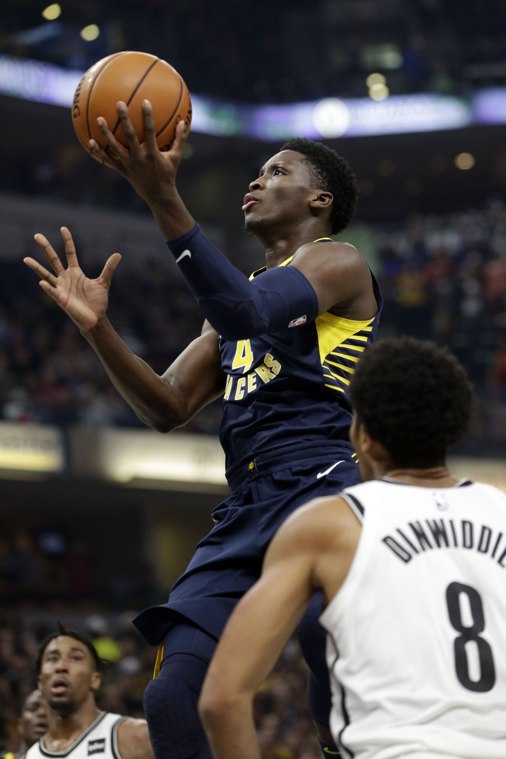 Indiana Pacers guard Victor Oladipo (4) shoots in front of Brooklyn Nets guard Spencer Dinwiddie (8) during the first half of an NBA basketball game i...
