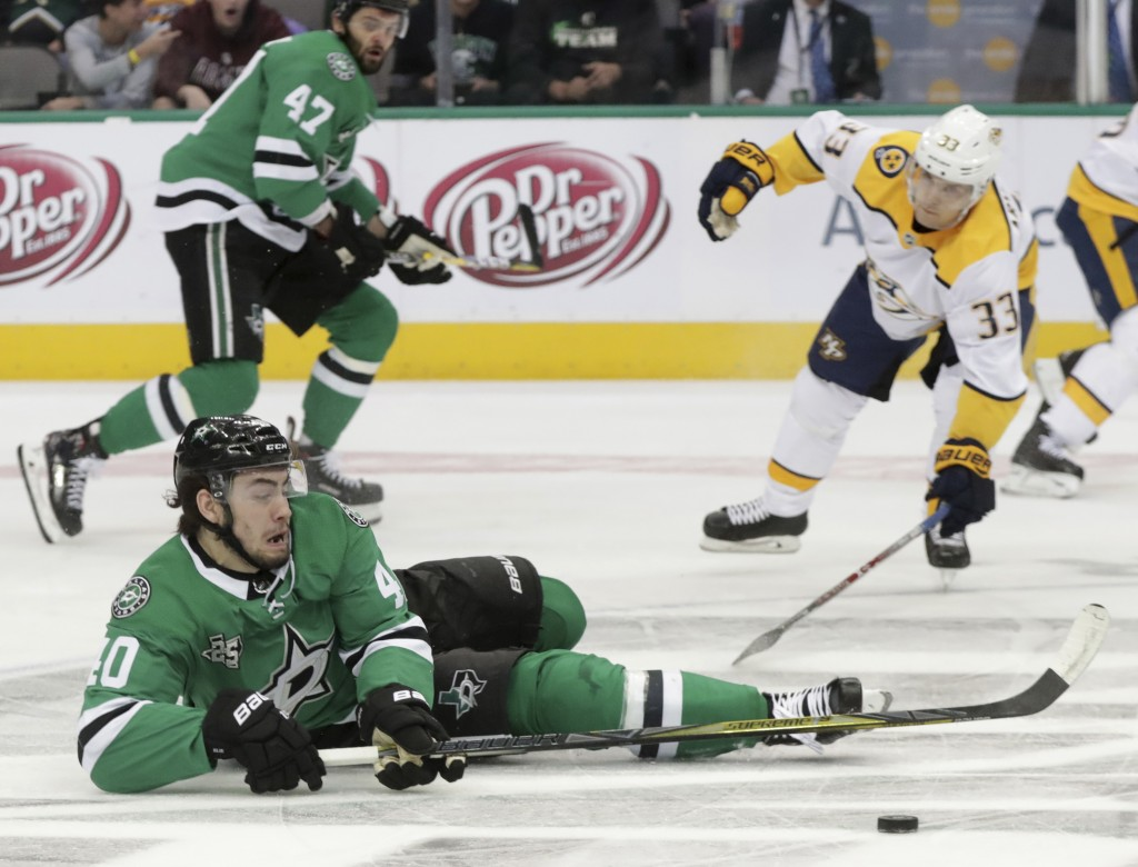 Dallas Stars left wing Remi Elie (40) falls in front in front of Nashville Predators left wing Viktor Arvidsson (33) during the first period of an NHL...