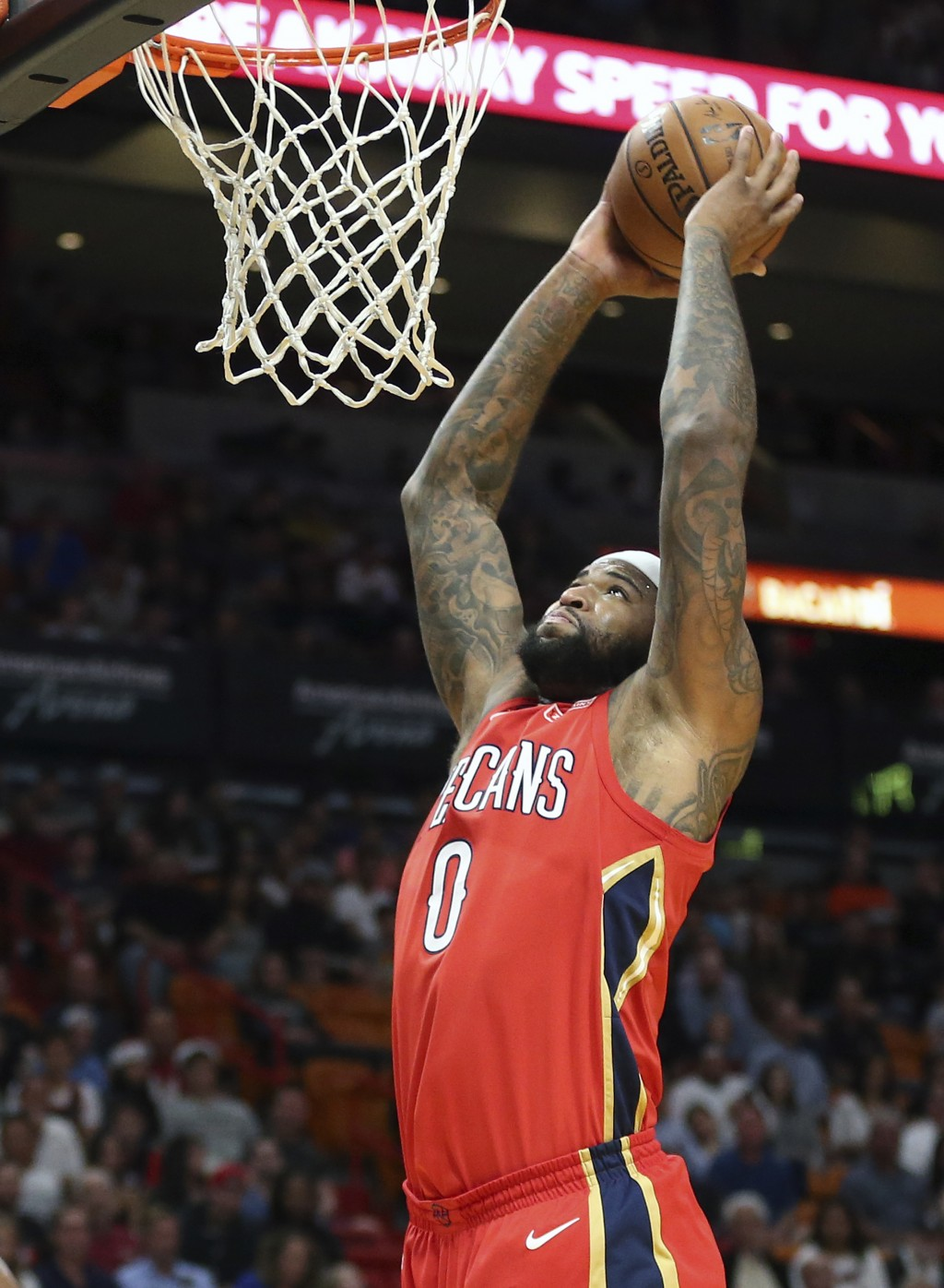 New Orleans Pelicans forward DeMarcus Cousins (0) goes to the basket against the Miami Heat during the first half of an NBA basketball game, Saturday,...