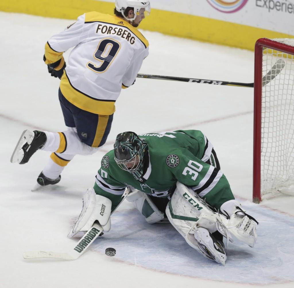 Dallas Stars goalie Ben Bishop (30) blocks a shot by Nashville Predators left wing Filip Forsberg (9) during an overtime shootout in an NHL hockey gam...