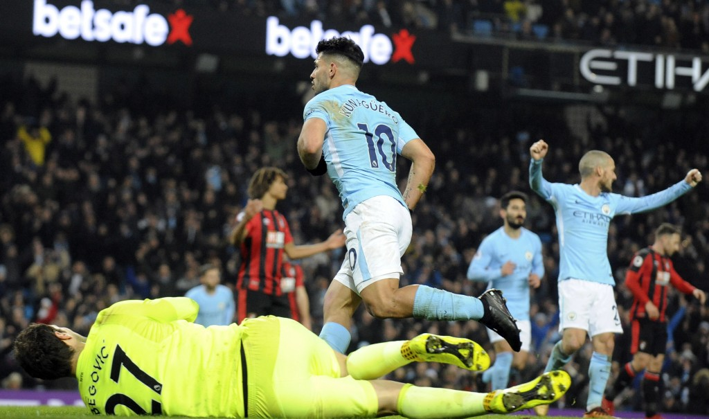 Manchester City's Sergio Aguero, centre, celebrates after scoring his second goal, his side's third, during the English Premier League soccer match be...