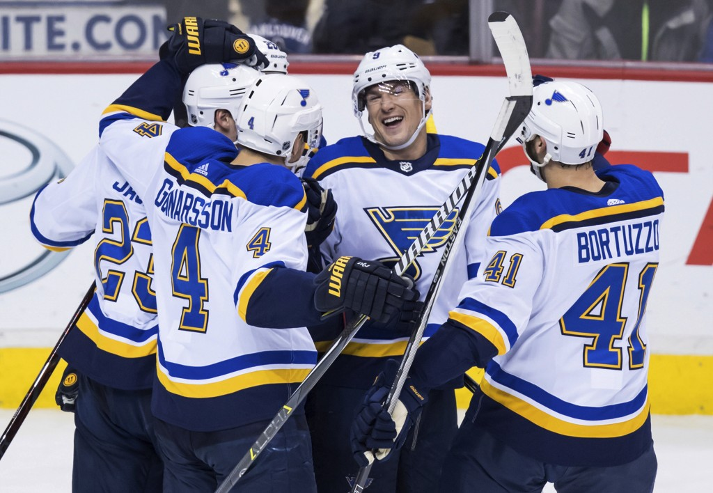 St. Louis Blues' Dmitrij Jaskin, of Russia; Kyle Brodziak; Carl Gunnarsson, of Sweden; Scottie Upshall; and Robert Bortuzzo, from left, celebrate Brod...