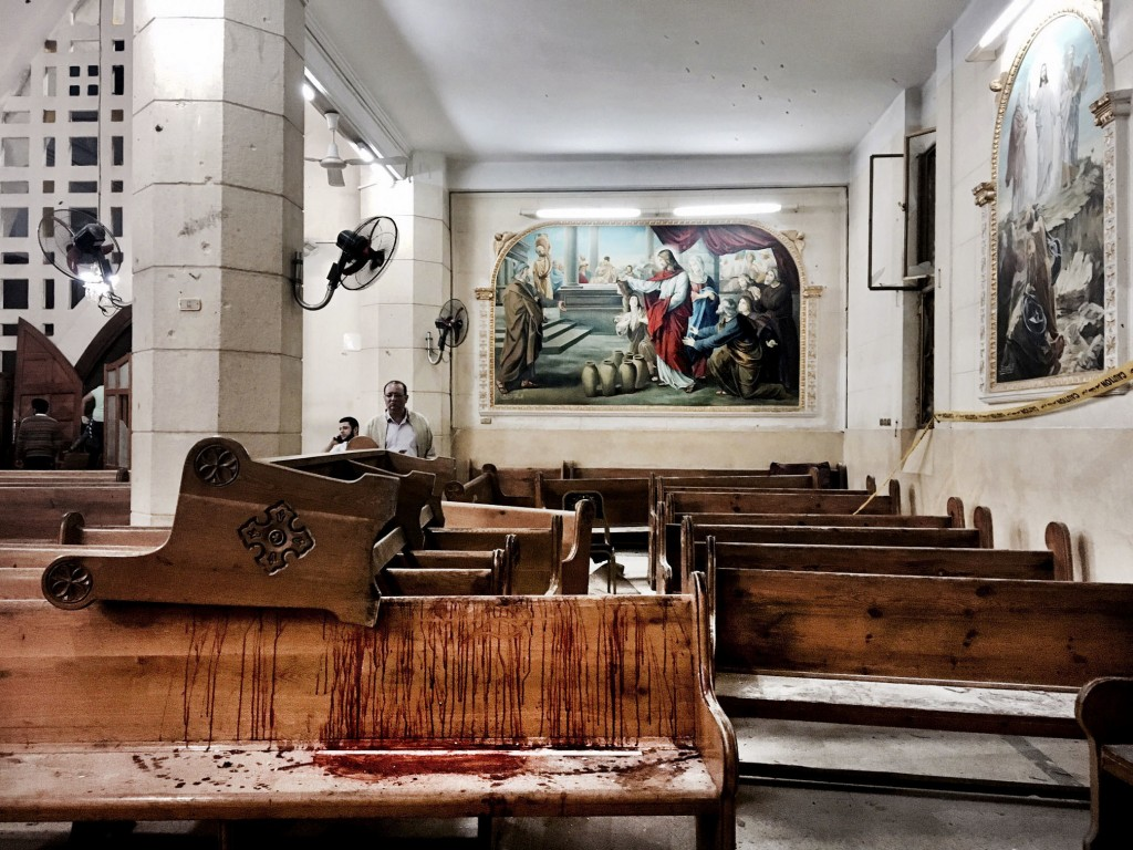 Blood stains pews inside the St. George Church after a suicide bombing, in the Nile Delta town of Tanta, Egypt, Sunday, April 9, 2017. Bombs exploded ...
