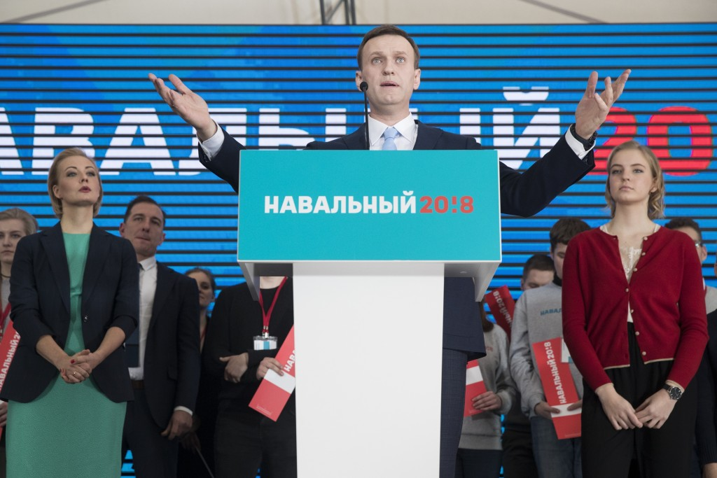 Russian opposition leader Alexei Navalny gestures while speaking during his supporters' meeting that nominated him for the presidential election race ...