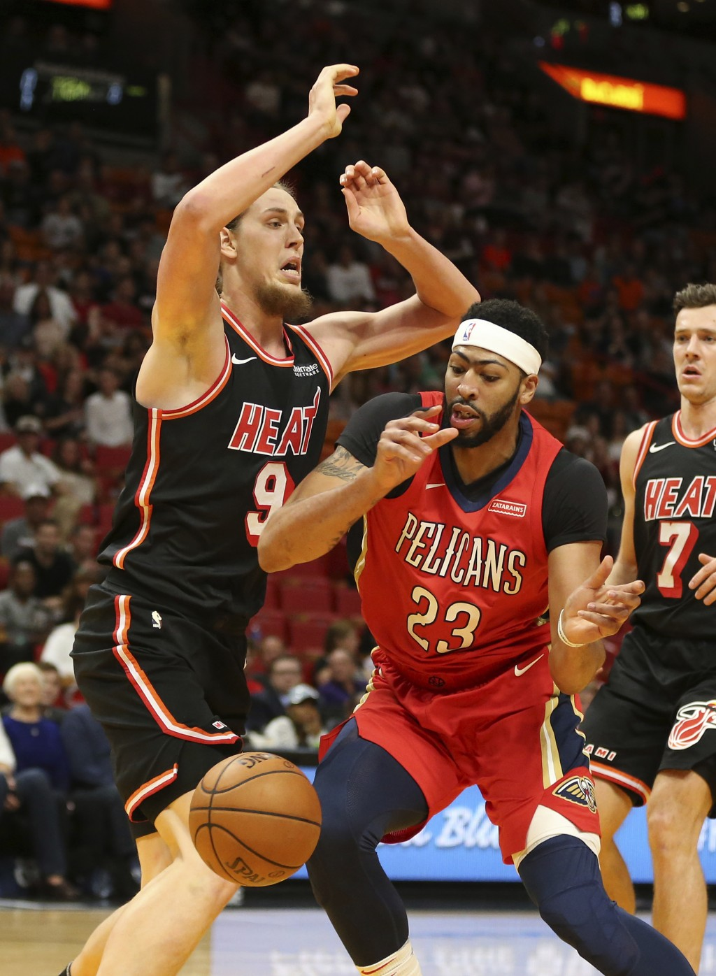 New Orleans Pelicans forward Anthony Davis (23) loses the ball out of bounds while being defended by Miami Heat center Kelly Olynyk (9) during the fir...