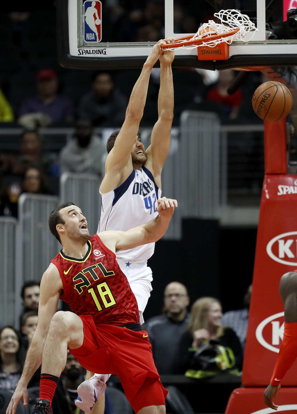 Dallas Mavericks' Maximilian Kleber, right, of Germany, dunks against Atlanta Hawks' Miles Plumlee in the first quarter of an NBA basketball game in A...