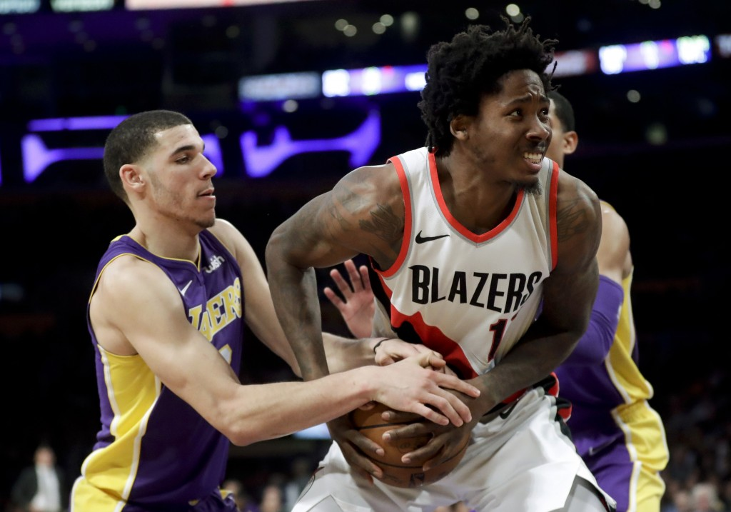 Los Angeles Lakers guard Lonzo Ball, left, fouls Portland Trail Blazers forward Ed Davis during the second half of an NBA basketball game in Los Angel...