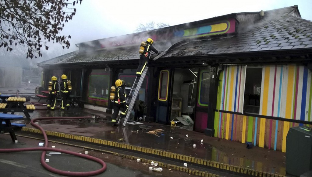 In this handout photo provided by the London Fire Brigade, firefighters work at the scene at Adventure cafe and shop near the Meerkat enclosure at Lon...