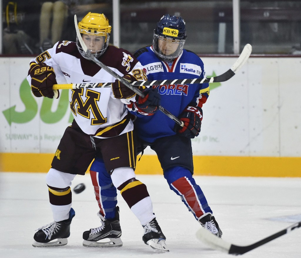 In this photo taken Sept. 24, 2017, South Korea's Marissa Brandt, right, defends against Minnesota forward Nicole Schammel in the first period of an e...