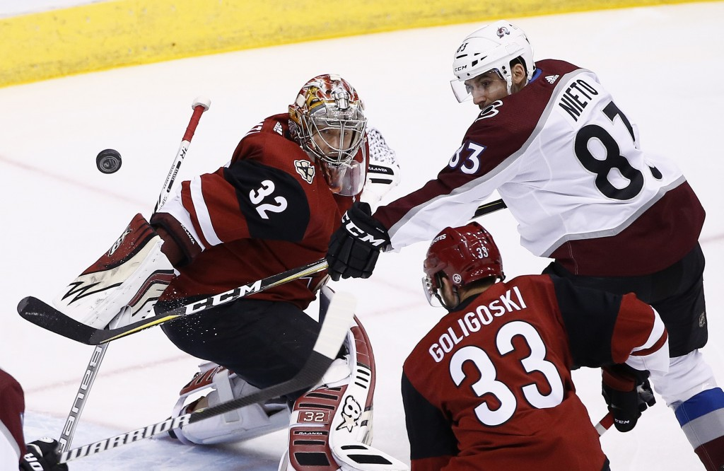 Colorado Avalanche left wing Matt Nieto (83) tries to redirect the puck as Arizona Coyotes goalie Antti Raanta (32) moves in to stop the puck while Co...