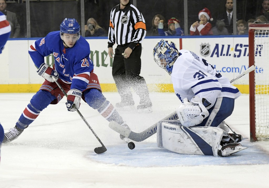 Toronto Maple Leafs goalie Frederik Andersen (31) stops a shot by New York Rangers left wing Jimmy Vesey (26) during the second period of an NHL hocke...