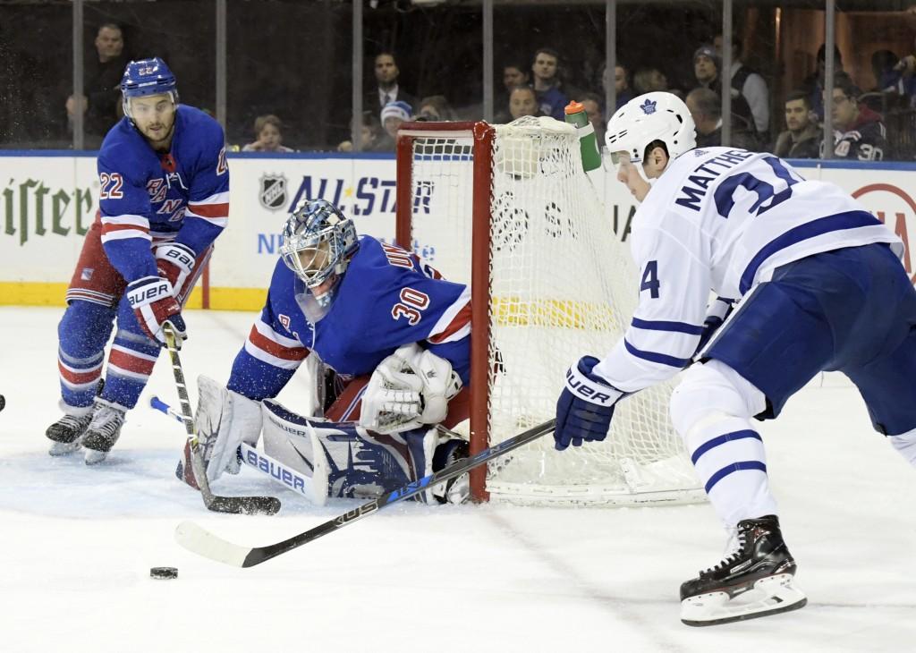 Toronto Maple Leafs center Auston Matthews (34) skates after the puck as New York Rangers goalie Henrik Lundqvist (30) protects the net and Rangers de...