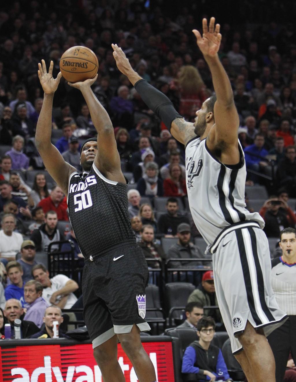 Sacramento Kings forward Zach Randolph (50) shoots over San Antonio Spurs' LaMarcus Aldridge during the first half of an NBA basketball game in Sacram...