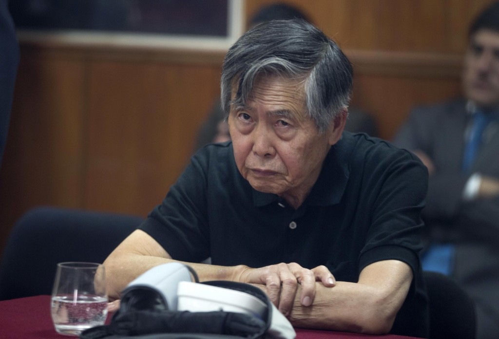 FILE - In this Oct. 25, 2013 file photo, Peru's jailed, former President Alberto Fujimori attends his hearing at a police base on the outskirts of Lim...