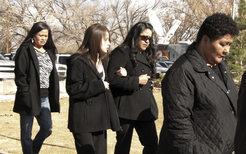 FILE - In this Jan. 14, 2010, file photo, Tanya Romans, right, is followed by unidentified family members attending the sentencing of a 10-year-old bo...
